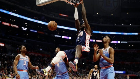 <p>               Los Angeles Clippers' Montrezl Harrell (5) dunks against the Sacramento Kings during the first half of an NBA basketball game Sunday, Jan. 27, 2019, in Los Angeles. (AP Photo/Marcio Jose Sanchez)             </p>