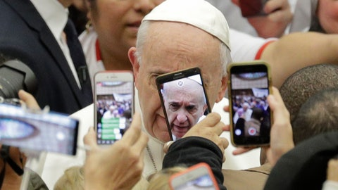 <p>               Pope Francis is framed by cellphones as he arrives for his weekly general audience, in the Pope Paul VI hall, at the Vatican, Wednesday, Jan. 9, 2019. (AP Photo/Andrew Medichini)             </p>