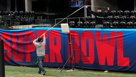 <p>               Workers use a tape measure as they hang a sign inside Mercedes-Benz Stadium for the NFL Super Bowl 53 football game Tuesday, Jan. 29, 2019, in Atlanta. (AP Photo/David J. Phillip)             </p>