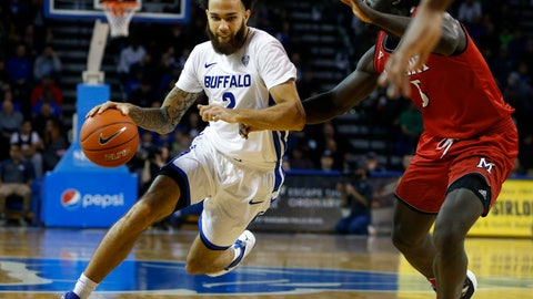 <p>               Buffalo guard Jeremy Harris (2) drives into the lane against Miami of Ohio guard Jalen Adaway (3) during the first half of an NCAA college basketball game, Saturday, Jan. 12, 2019, in Buffalo N.Y. (AP Photo/Jeffrey T. Barnes)             </p>