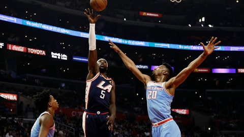<p>               Los Angeles Clippers' Montrezl Harrell (5) shoots between Sacramento Kings' De'Aaron Fox, left, and Harry Giles (20) during the first half of an NBA basketball game Sunday, Jan. 27, 2019, in Los Angeles. (AP Photo/Marcio Jose Sanchez)             </p>