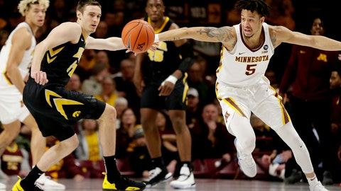 <p>               Iowa forward Nicholas Baer (51) and Minnesota guard Amir Coffey (5) vie for the ball during the first half of an NCAA college basketball game Sunday, Jan. 27, 2019, in Minneapolis. (AP Photo/Andy Clayton-King)             </p>