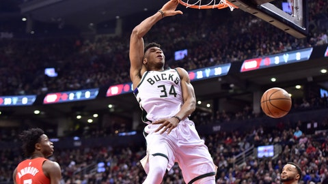 <p>               Milwaukee Bucks forward Giannis Antetokounmpo (34) dunks as Toronto Raptors forwards OG Anunoby (3) and Norman Powell (24) latch during first -half NBA basketball action in Toronto, Thursday Jan. 31, 2019. (Frank Gunn/The Canadian Press via AP)             </p>