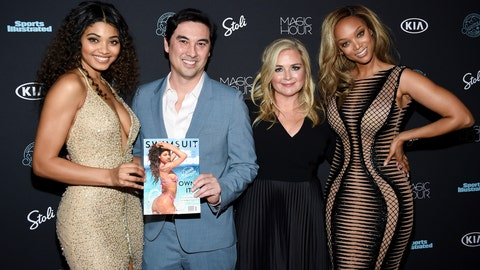 """<p>               FILE - In this Feb. 14, 2018 file photo, model Danielle Herrington,  from left, Sports Illustrated editor-in-chief Chris Stone, S.I. Swimsuit editor MJ Day, and model Tyra Banks attend the 2018 Sports Illustrated Swimsuit Issue launch party in New York. The upcoming Sports Illustrated Swimsuit Issue is moving its publication date, pushing it from the chill of February to warmer May, closer to bikini-weather. Editor of the issue MJ Day says the shift makes more sense for greater impact. She says; """"It's always hard to think about buying a swimsuit when its 18 degrees out.""""  (Photo by Evan Agostini/Invision/AP, File)             </p>"""