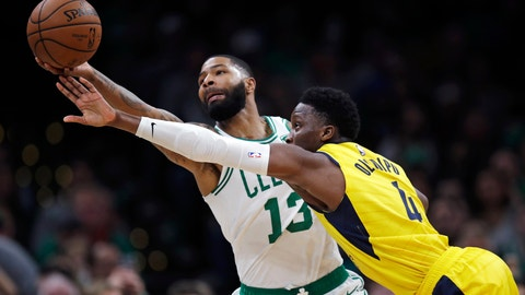 <p>               Boston Celtics forward Marcus Morris (13) grabs a pass against Indiana Pacers guard Victor Oladipo (4) during the second half of an NBA basketball game in Boston, Wednesday, Jan. 9, 2019. The Celtics defeated the Pacers 135-108. (AP Photo/Charles Krupa)             </p>