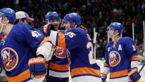 <p>               New York Islanders' Devon Toews celebrates with teammates after scoring the game winning goal in the overtime period of an NHL hockey game Thursday, Jan. 3, 2019, in Uniondale, N.Y. The Islanders won 3-2. (AP Photo/Frank Franklin II)             </p>