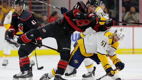 <p>               Carolina Hurricanes' Andrei Svechnikov (37), of Russia, collides with Nashville Predators' Austin Watson (51) during the second period of an NHL hockey game in Raleigh, N.C., Sunday, Jan. 13, 2019. (AP Photo/Gerry Broome)             </p>