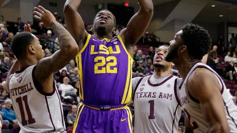 <p>               LSU forward Darius Days (22) puts up a shot in the middle of Texas A&M guard Wendell Mitchell (11), guard Savion Flagg (1) and guard Frank Byers, right, during the first half of an NCAA college basketball game Wednesday, Jan. 30, 2019, in College Station, Texas. (AP Photo/Michael Wyke)             </p>