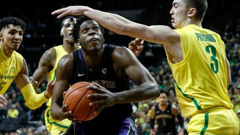 <p>               Washington forward Noah Dickerson, looks for a shot as Oregon guard Payton Pritchard (3) defends during an NCAA college basketball game Thursday, Jan. 24, 2019, in Eugene, Ore. (AP Photo/Thomas Boyd)             </p>