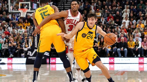 <p>               Utah Jazz guard Grayson Allen (24) uses forward Derrick Favors (15) to get away from Chicago Bulls guard Shaquille Harrison (3) during the second quarter of an NBA basketball game Saturday, Jan. 12, 2019, in Salt Lake City. (AP Photo/Chris Nicoll)             </p>