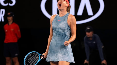 <p>               Russia's Maria Sharapova celebrates a point win over Denmark's Caroline Wozniacki during their third round match at the Australian Open tennis championships in Melbourne, Australia, Friday, Jan. 18, 2019. (AP Photo/Kin Cheung)             </p>