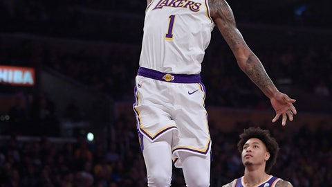 <p>               Los Angeles Lakers guard Kentavious Caldwell-Pope, left, goes up for a dunk as Phoenix Suns forward Kelly Oubre Jr. watches during the first half of an NBA basketball game Sunday, Jan. 27, 2019, in Los Angeles. (AP Photo/Mark J. Terrill)             </p>
