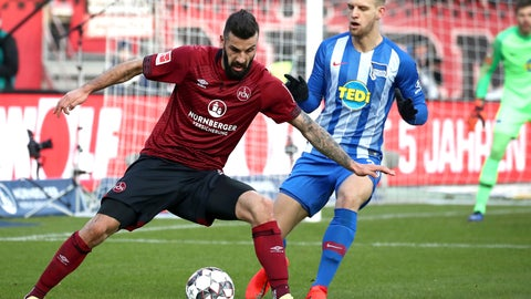 <p>               Nuremberg's Mikael Ishak, left, and Berlin's Arne Maier, right, challenge for the ball during the German Bundesliga soccer match between 1. FC Nuremberg and Hertha BSC Berlin in Nuremberg, Germany, Sunday, Jan. 20, 2019. (Daniel Karmann/dpa via AP)             </p>