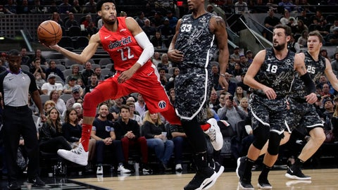 <p>               Washington Wizards forward Otto Porter Jr. (22) chases a loose ball past San Antonio Spurs forward Dante Cunningham (33) during the first half of an NBA basketball game in San Antonio, Sunday, Jan. 27, 2019. (AP Photo/Eric Gay)             </p>