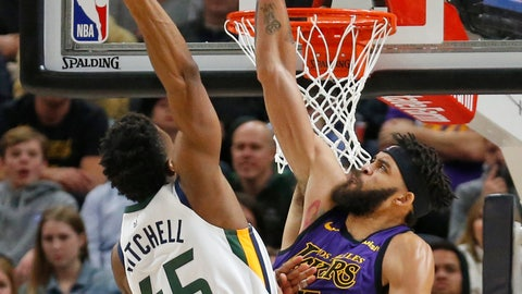<p>               Utah Jazz guard Donovan Mitchell (45) dunks on Los Angeles Lakers center JaVale McGee (7) during the first half of an NBA basketball game Friday, Jan. 11, 2019, in Salt Lake City. (AP Photo/Rick Bowmer)             </p>