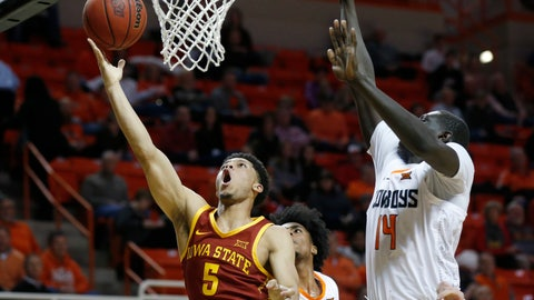 <p>               Iowa State guard Lindell Wigginton (5) shoots in front of Oklahoma State forward Yor Anei (14) during the second half of an NCAA college basketball game in Stillwater, Okla., Wednesday, Jan. 2, 2019. (AP Photo/Sue Ogrocki)             </p>