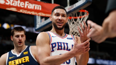 <p>               Philadelphia 76ers guard Ben Simmons, front, argues for a call after driving to the rim for a shot past Denver Nuggets center Nikola Jokic during the first half of an NBA basketball game Saturday, Jan. 26, 2019, in Denver. (AP Photo/David Zalubowski)             </p>