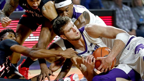 <p>               Texas Tech's Jarrett Culver, left, tries to steal the ball from Kansas State's Dean Wade during the second half of an NCAA college basketball game Tuesday, Jan. 22, 2019, in Manhattan, Kan. Kansas State won 58-45. (AP Photo/Charlie Riedel)             </p>