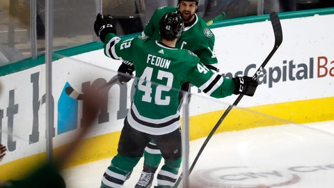 <p>               Dallas Stars defenseman Taylor Fedun (42) and left wing Jamie Benn (14) celebrate a goal by Benn during the first period of the team's NHL hockey game against the Buffalo Sabres in Dallas, Wednesday, Jan. 30, 2019. (AP Photo/Tony Gutierrez)             </p>