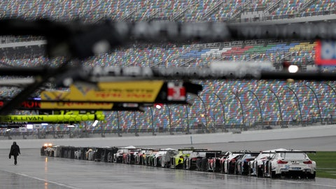 <p>               Cars from the IMSA 24-hour race sit idle on pit road after the race was red-flagged because of rain at Daytona International Speedway, Sunday, Jan. 27, 2019, in Daytona Beach, Fla. (AP Photo/John Raoux)             </p>
