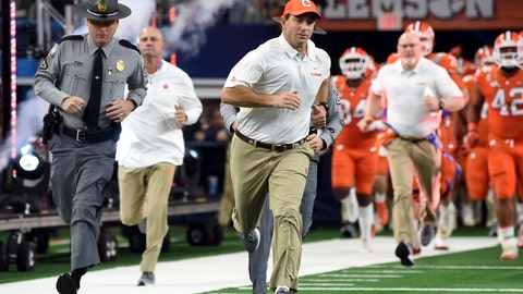 <p>               Clemson head coach Dabo Swinney jogs onto the field for the first half of the NCAA Cotton Bowl semi-final playoff football game against Notre Dame on Saturday, Dec. 29, 2018, in Arlington, Texas. (AP Photo/Jeffrey McWhorter)             </p>