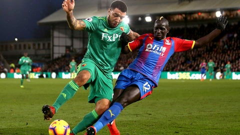 <p>               Watford's Troy Deeney, left, and Crystal Palace's Mamadou Sakho fight for the ball during the English Premier League soccer match between Crystal Palace and Watford Town at the Selhurst Park stadium, London. Saturday, Jan. 12, 2019 (John Walton/PA via AP)             </p>