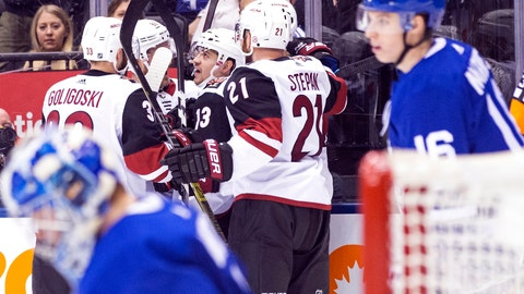 <p>               Arizona Coyotes' Vinnie Hinostroza (13) celebrates with teammates after scoring against the Toronto Maple Leafs during third period NHL hockey action in Toronto on Sunday, Jan. 20, 2019. (Chris Young/The Canadian Press via AP)             </p>