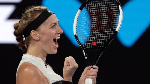 <p>               Petra Kvitova of the Czech Republic celebrates after defeating Australia's Ashleigh Barty in their quarterfinal match at the Australian Open tennis championships in Melbourne, Australia, Tuesday, Jan. 22, 2019. (AP Photo/Aaron Favila)             </p>