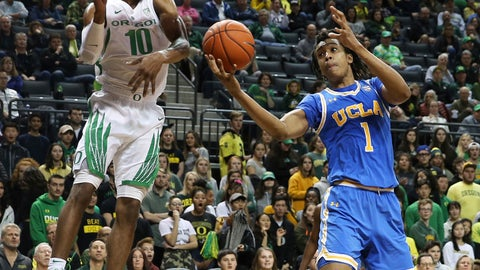 <p>               Oregon's Victor Bailey, left, and UCLA's Moses Brown battle for a rebound during the first half an NCAA college basketball game Thursday, Jan 10, 2019, in Eugene, Ore. (AP photo/Chris Pietsch)             </p>