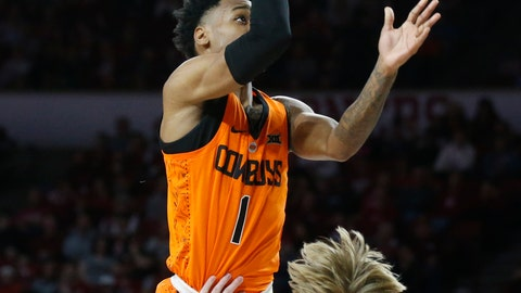 <p>               Oklahoma State guard Curtis Jones (1) collides with Oklahoma forward Brady Manek (35) as he shoots in the first half of an NCAA college basketball game in Norman, Okla., Saturday, Jan. 5, 2019. (AP Photo/Sue Ogrocki)             </p>
