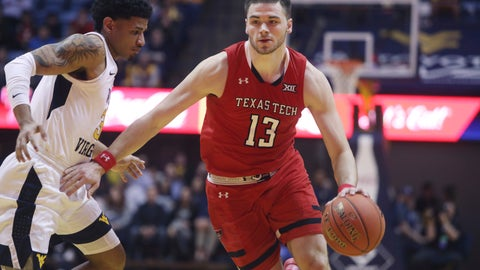 <p>               Texas Tech guard Matt Mooney (13) drives up court while defended by West Virginia guard James Bolden (3) during the first half of an NCAA college basketball game Wednesday, Jan. 2, 2019, in Morgantown, W.Va. (AP Photo/Raymond Thompson)             </p>