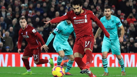 <p>               Liverpool's Mohamed Salah scores his side's fourth goal of the game against Arsenal, during their English Premier League soccer match at Anfield Stadium in Liverpool, England, Saturday Dec. 29, 2018. (Peter Byrne/PA via AP)             </p>