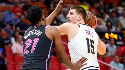 <p>               Denver Nuggets center Nikola Jokic (15) looks for an open teammate past Miami Heat center Hassan Whiteside (21) during the first half of an NBA basketball game, Tuesday, Jan. 8, 2019, in Miami. (AP Photo/Wilfredo Lee)             </p>