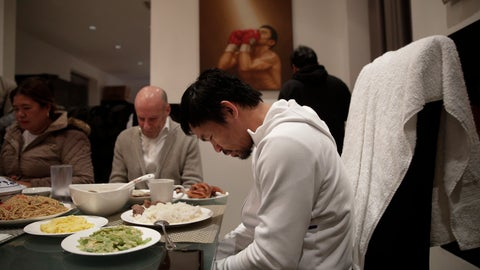 <p>               Boxer Manny Pacquiao prays before breakfast at his home following his morning run Monday, Jan. 14, 2019, in Los Angeles. Breakfast at Manny Pacquiao's house began with a silent prayer, followed by more silence around the big dining room table as his entourage waited for the fighter to take the first bite. (AP Photo/Jae C. Hong)             </p>