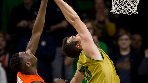 <p>               Syracuse's Bourama Sidibe (34) and Notre Dame's John Mooney (33) compete for a rebound during the second half of an NCAA college basketball game Saturday, Jan. 5, 2019, in South Bend, Ind. Syracuse won 72-62. (AP Photo/Robert Franklin)             </p>