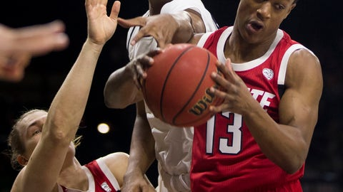 <p>               North Carolina State's C.J. Bryce (13) grabs a rebound over teammate Wyatt Walker (33) and Notre Dame's D.J. Harvey during the first half of an NCAA college basketball game Saturday, Jan. 19, 2019, in South Bend, Ind. (AP Photo/Robert Franklin)             </p>