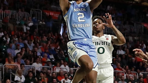 <p>               North Carolina guard Coby White shoots and scores against Miami guard Chris Lykes during the first half of an NCAA college basketball game on Saturday, Jan. 19, 2019, in Coral Gables, Fla. (AP Photo/Brynn Anderson)             </p>
