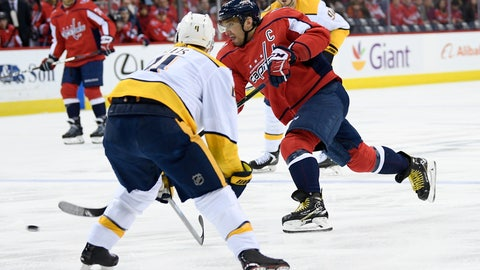 <p>               Washington Capitals left wing Alex Ovechkin (8), of Russia, shoots against Nashville Predators defenseman Ryan Ellis (4) during the first period of an NHL hockey game, Monday, Dec. 31, 2018, in Washington. (AP Photo/Nick Wass)             </p>