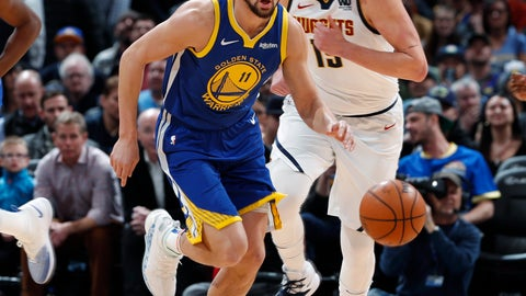 <p>               Golden State Warriors guard Klay Thompson, front, tracks down a loose ball as Denver Nuggets center Nikola Jokic follows in the first half of an NBA basketball game, Tuesday, Jan. 15, 2019, in Denver. (AP Photo/David Zalubowski)             </p>