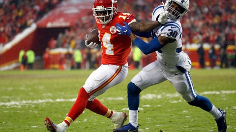 <p>               Kansas City Chiefs wide receiver Sammy Watkins (14) is tackled by Indianapolis Colts defensive back George Odum (30) during the first half of an NFL divisional football playoff game in Kansas City, Mo., Saturday, Jan. 12, 2019. (AP Photo/Charlie Riedel)             </p>
