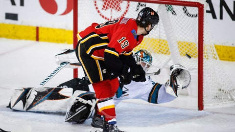 <p>               San Jose Sharks goalie Aaron Dell lets in a goal from Calgary Flames' Matthew Tkachuk during the second period of an NHL hockey game Monday, Dec. 31, 2018, in Calgary, Alberta. (Jeff McIntosh/The Canadian Press via AP)             </p>
