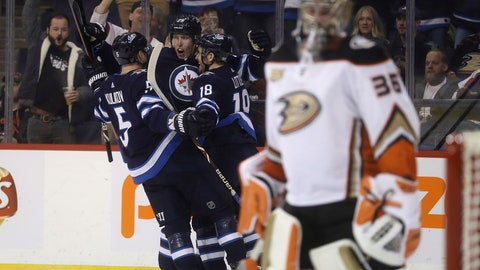 <p>               Winnipeg Jets' Dmitry Kulikov (5), Patrik Laine (29) and Bryan Little (18) celebrate after Laine scored against Anaheim Ducks goaltender John Gibson (36) during second-period NHL hockey game action in Winnipeg, Manitoba, Sunday, Jan. 13, 2019. (Trevor Hagan/The Canadian Press via AP)             </p>