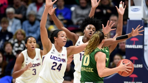 <p>               South Florida Enna Pehadzic (0) is double teamed by Connecticut's Napheesa Collier (24) and Christyn Williams (13) in the first half of an NCAA college basketball game, Sunday, Jan. 13, 2019, in Storrs, Conn. (AP Photo/Stephen Dunn)             </p>