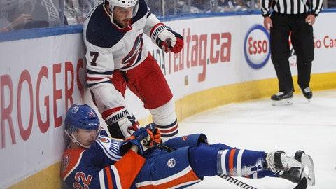 <p>               Winnipeg Jets' Ben Chiarot (7) checks Edmonton Oilers' Tobias Rieder (22) during second-period NHL hockey game action in Edmonton, Alberta, Monday, Dec. 31, 2018. (Jason Franson/The Canadian Press via AP)             </p>