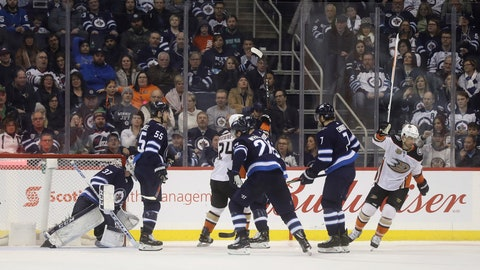 <p>               Anaheim Ducks' Carter Rowney (24) and Andrew Cogliano (7) celebrate after Cogliano scored against Winnipeg Jets goaltender Connor Hellebuyck (37) during second-period NHL hockey game action in Winnipeg, Manitoba, Sunday, Jan. 13, 2019. (Trevor Hagan/The Canadian Press via AP)             </p>