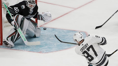 <p>               Metropolitan Division's Sidney Crosby, of the Pittsburgh Penguins, scores a goal past Central Division's Devan Dubnyk, of the Minnesota Wild, during the first half of the NHL hockey All-Star Game final in San Jose, Calif., Saturday, Jan. 26, 2019. (AP Photo/Jeff Chiu)             </p>