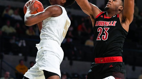 <p>               Georgia Tech forward Moses Wright looks to the basket as Louisville center Steven Enoch (23) defends during the second half of an NCAA college basketball game Saturday, Jan. 19, 2019, in Atlanta. Louisville won 79-51. (AP Photo/John Amis)             </p>