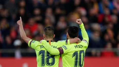 <p>               FC Barcelona's Lionel Messi, right, celebrates after scoring with his teammate Jordi Alba during the Spanish La Liga soccer match between Girona and FC Barcelona at the Montilivi stadium in Girona, Spain, Sunday, Jan. 27, 2019. (AP Photo/Manu Fernandez)             </p>