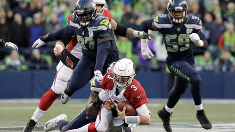 <p>               Arizona Cardinals quarterback Josh Rosen (3) is sacked by Seattle Seahawks' Jarran Reed during the second half of an NFL football game, Sunday, Dec. 30, 2018, in Seattle. (AP Photo/Ted S. Warren)             </p>