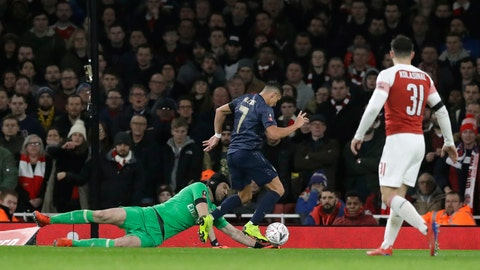 <p>               Manchester United's Alexis Sanchez, right, scores his side's opening goal during the English FA Cup fourth round soccer match between Arsenal and Manchester United at the Emirates stadium in London, Friday, Jan. 25, 2019. (AP Photo/Matt Dunham)             </p>